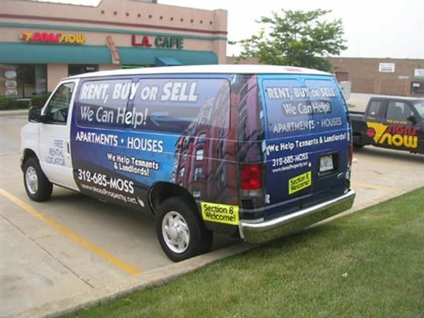 Digitally printed vinyl vehicle wrap and window graphics serve as mobile advertisement for Moss Property